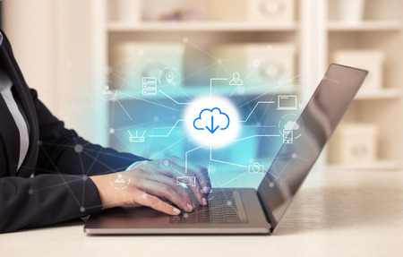 Business woman working on her laptop with online storage and cloud technology concept Stock Photo