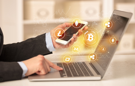 Business woman working on laptop with bitcoin link network and online concept