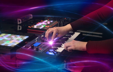 Hand mixing music on midi controller with wave vibe concept Stock Photo