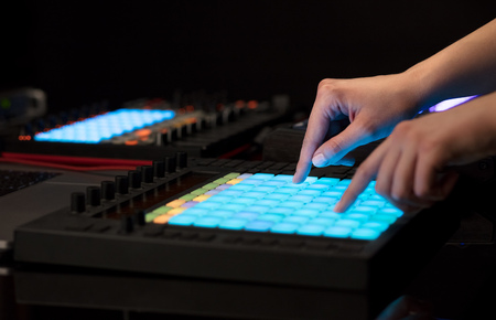 Hand mixing music on midi controller