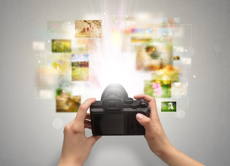 Hand captures life events with digital camera Stock Photo