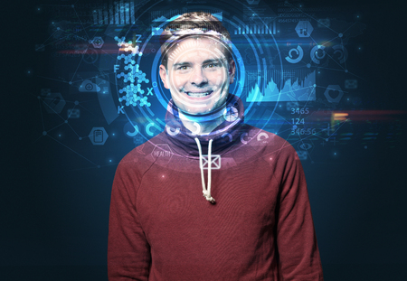 Young man on dark background, face recognition concept