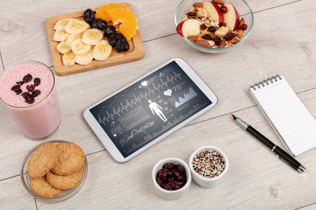 Healthy food composition with tablet Stock Photo