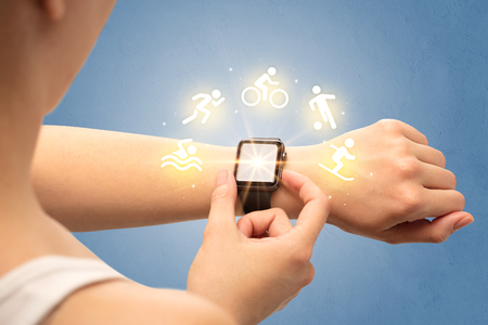 Female hand with smartwatch and sport concept.