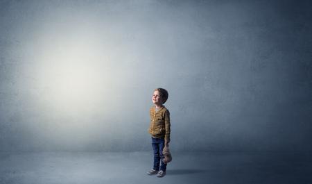 Little waggish kid in an empty room