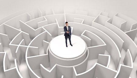 Businessman standing on the top of a maze Stock Photo