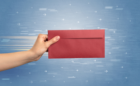 Female hand holding empty and full envelope with blue background and direction concept