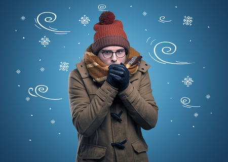 Frozen boy with doodled snowflake and windy concept Stock Photo