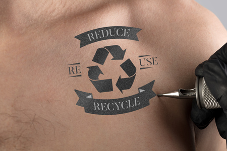 Tattooing recycle for a better environment concept on naked back