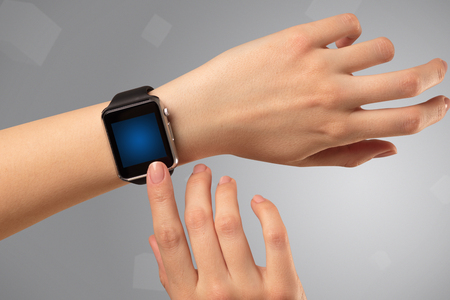Female hand wearing smartwatch