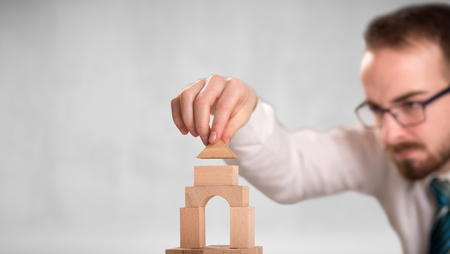 Businessman building a tower