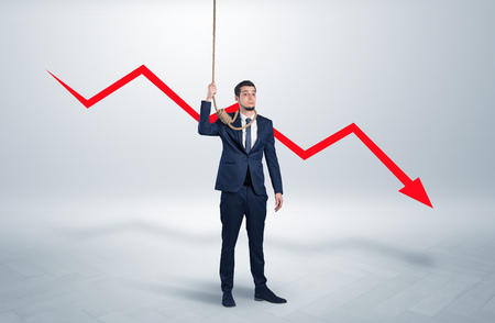 Concept of stressed businessman with arrow declining behind him Stock Photo