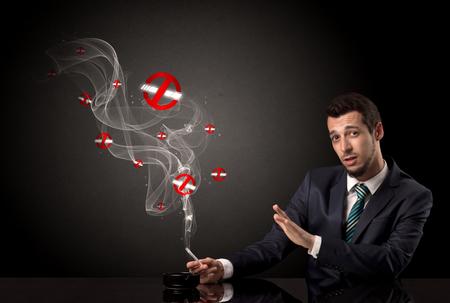 Businessman smoking concept Banque d'images