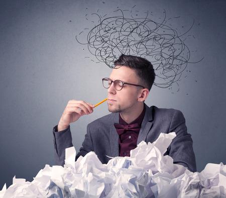 Businessman above crumpled paper