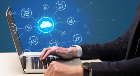 Hand typing with cloud technology system concept Stock Photo