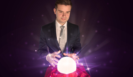 Businessman sitting with crystal ball in action
