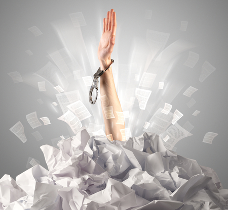 Hand coming out from paper pile Stock Photo - 107368618