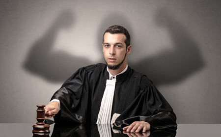 Brawny judge making decision Stock Photo
