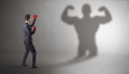 Businessman fighting with his bossy shadow Фото со стока - 107252168