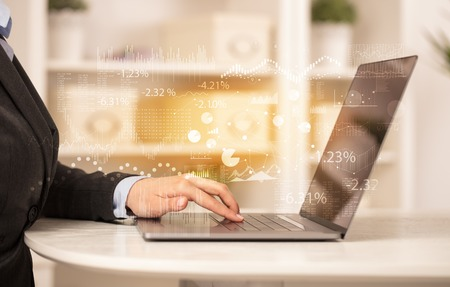 Business woman working on laptop with financial report concept Фото со стока
