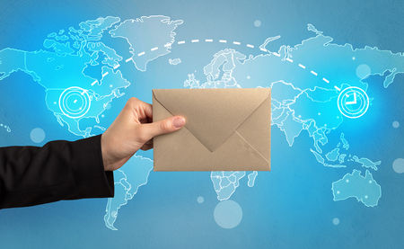 Hand holding envelope with global concept