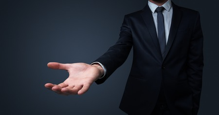 Businessman handing something without concept Imagens
