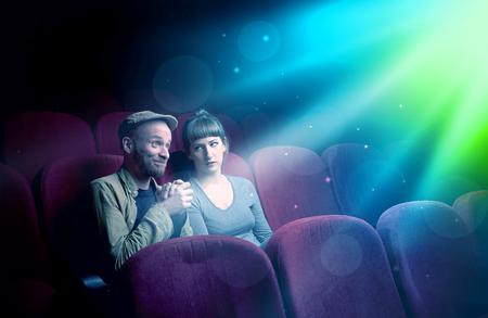 Teenager couple watching movie