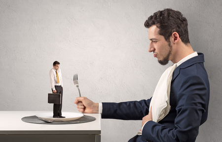 Small scared businessman almost devoured