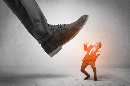 Large foot stepping down small man