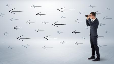 Man looking with binoculars and arrows around Stock fotó