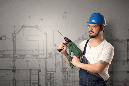 Worker with technical drawing. Stock Photo