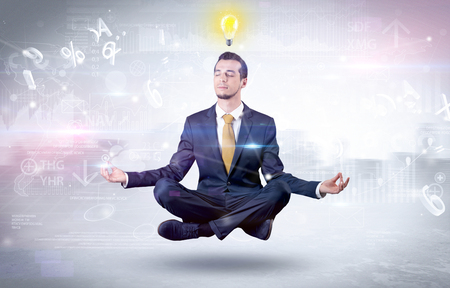 Businessman meditates with enlightenment concept 版權商用圖片