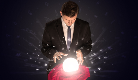 Businessman looking to inspiration in a magic ball and doodle concept Archivio Fotografico