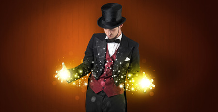 Illusionist holding superpower on his hand Stock Photo