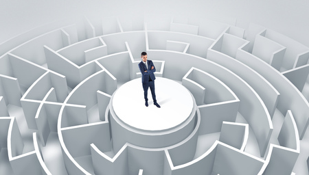 Businessman standing on the top of a maze Stockfoto