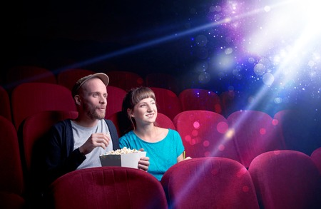 Romantic couple sitting at spectacle