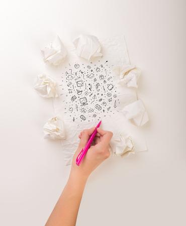 Writing hand in crumpled paper Foto de archivo