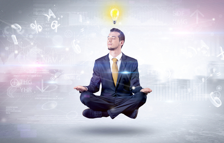 Businessman meditates with enlightenment concept 스톡 콘텐츠