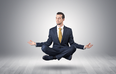 Businessman meditates in an empty space concept