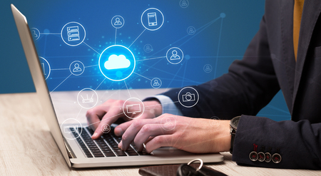 Hand typing with cloud technology system concept Foto de archivo