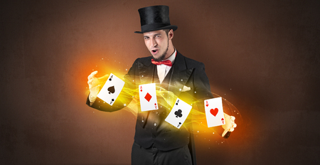 Illusionist making trick with magical play cards Stock Photo