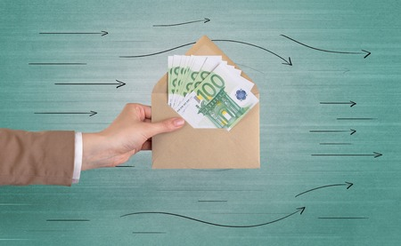 Hand holding envelope with arrows around