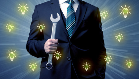 Leader standing with tools on his hand Stock Photo