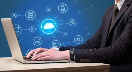 Hand typing with cloud technology system concept Standard-Bild