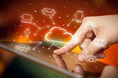 Hand working on tablet with cloud technology system concept