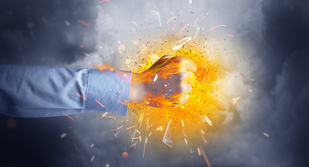 Hand hits strongly and makes fire beam around Stock Photo