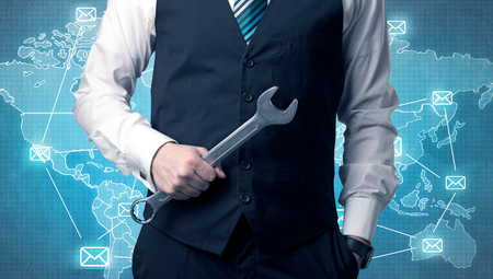 Handsome businassman standing with tool on his hand