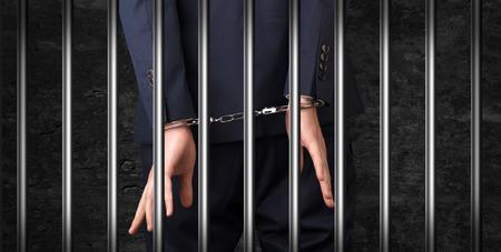 Close handcuffed man in jail Standard-Bild - 109828301