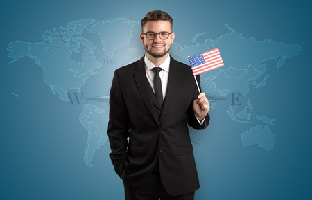 Man standing with flag and map background Banque d'images
