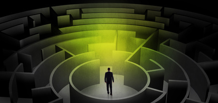 Businessman choosing between entrances in a middle of a dark maze